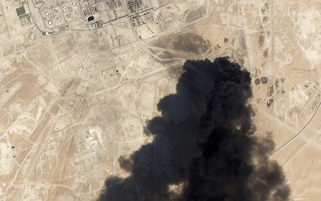 Satellite image from Planet Labs Inc. shows thick black smoke rising from Saudi Aramco's Abqaiq oil processing facility in Buqyaq, Saudi Arabia, September 14, 2019. (Planet Labs Inc via AP)