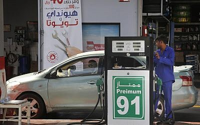 A worker refuels a car at a gas station in Jiddah, Saudi Arabia, September 16, 2019. (Amr Nabil/AP)
