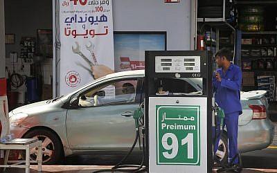 A worker refuels a car at a gas station in Jiddah, Saudi Arabia, September 16, 2019. (Amr Nabil/AP)