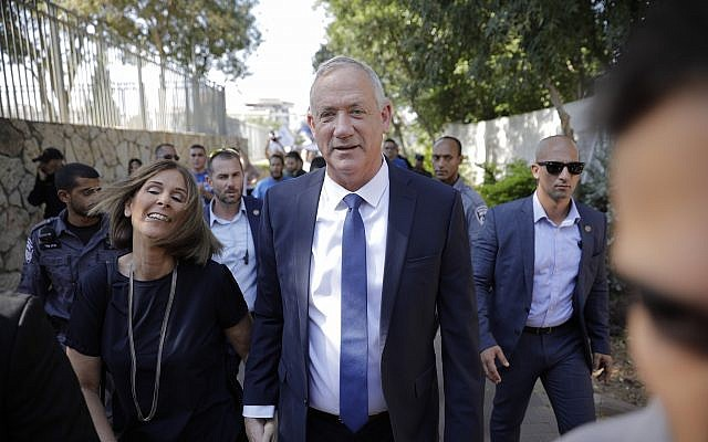 Blue and White party leader Benny Gantz and his wife Revital leave a polling station in Rosh Ha'ayin on election day, September 17, 2019. (AP Photo/Sebastian Scheiner)