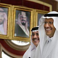 Energy Minister Prince Abdulaziz bin Salman, right, and Aramco CEO Amin Al-Nasser smile as they leave a press conference in Jiddah, Saudi Arabia, September 17, 2019. (AP Photo/Amr Nabil)