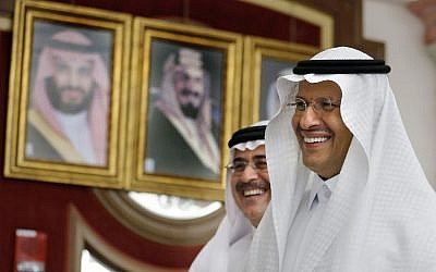 Energy Minister Prince Abdulaziz bin Salman, right, and Aramco CEO Amin Al-Nasser smile as they leave a press conference in Jiddah, Saudi Arabia, September 17, 2019. (AP Photo/Amr Nabil)