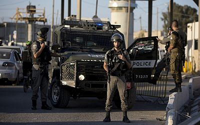 In this Wednesday, Sep. 18, 2019 photo, Israeli police deploy at Qalandiya checkpoint after a knife-wielding Palestinian woman was shot and killed by private security guards, near Jerusalem. (AP Photo/Majdi Mohammed)