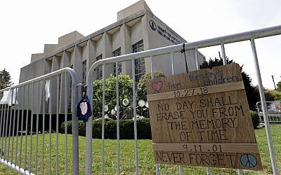 A sign hangs on a fence surrounding the Tree of Life synagogue in Pittsburgh on September 17, 2019. The first anniversary of the shooting at the synagogue, that killed 11 worshippers, is Oct., 27, 2019.  (AP Photo/Gene J. Puskar)