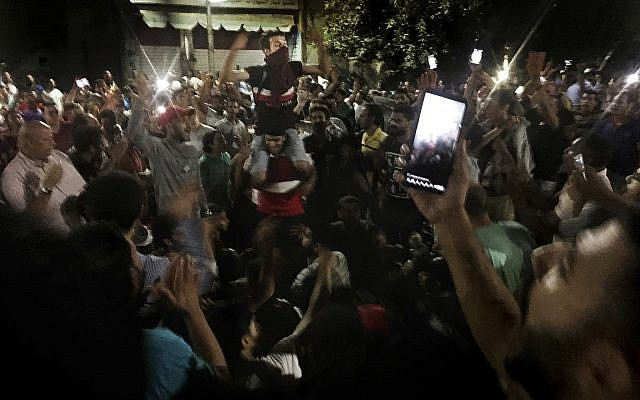 Protesters chant slogans against the regime in Cairo, Egypt, early Saturday, Sept. 21, 2019. Dozens of people held a rare protest in Cairo during which they called on Egyptian President Abdel-Fattah el-Sissi to quit. (AP Photo/Nariman El-Mofty)