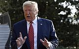 US President Donald Trump talks with reporters before leaving on Marine One on the South Lawn of the White House in Washington, September 22, 2019. (AP Photo/Susan Walsh)