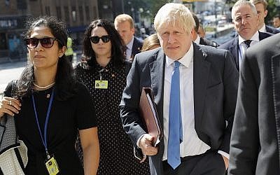 Britain's Prime Minister Boris Johnson walks down the street near United Nations headquarters in New York, September 23, 2019. (AP Photo/Seth Wenig)