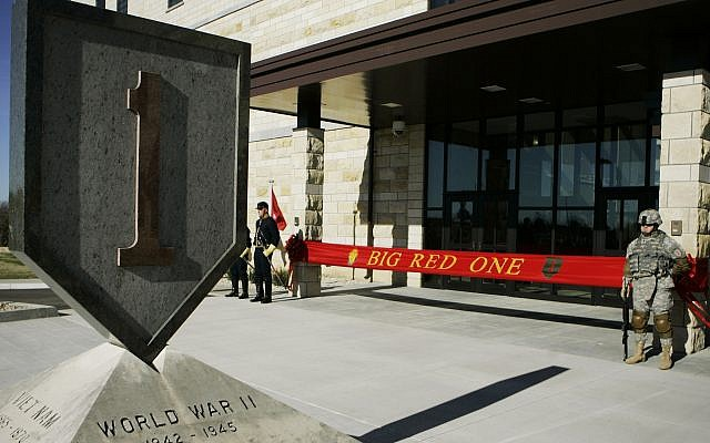 An honor guard stands at the entrance before ribbon cutting ceremonies for the new 1st Infantry Division Headquarters at Fort Riley, Kansas, on February 9, 2015. (AP Photo/Orlin Wagner File)