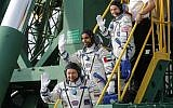 United Arab Emirates astronaut Hazzaa al Mansouri, centre, Russian cosmonaut Oleg Skripochka, bottom, and US astronaut Jessica Meir, top, members of the main crew to the International Space Station (ISS), board the Soyuz MS-15 spacecraft for the launch at the Russian leased Baikonur cosmodrome, Kazakhstan, September 25, 2019. (Maxim Shipenkov/Pool Photo via AP)