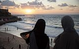 In this photo from September 23, 2019, Two Arab Israeli women overlook the Mediterranean sea, in the mixed Arab and Jewish city of Jaffa, near Tel Aviv. (AP Photo/Oded Balilty)
