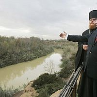 Russian President Vladimir Putin, accompanied by Archimandrite Tikhon, head of the Russian Orthodox mission in Jerusalem, and Jordan's Prince Ghazi, visits the Jordan River at the official baptism site of Jesus in the Jordan Valley during a visit to the holy Christian site, February 13, 2007. (AP Photo/ITAR-TASS, Dmitry Astakhov, Presidential Press Service)