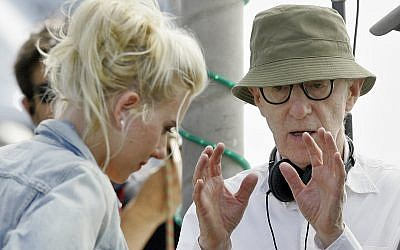 US film director Woody Allen, right, gives instruction to  actress Scarlett  Johansson on the first day's filming of his new movie in Barcelona, Spain, Monday July 9, 2007.   (AP Photo/Manu Fernandez)