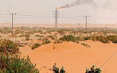 ILLUSTRATIVE -- A gas flame is seen near the Khurais oil facility in an area where operations are being expanded, about 60 miles southeast of Riyadh, Saudi Arabia, June 23, 2008 (AP Photo/Hasan Jamali)