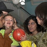 Moshe Holtzberg, 2-year-old orphan of the rabbi and his wife slain in the Mumbai Chabad House, is seen with his relatives at a synagogue in Mumbai, India, December 1, 2008. (AP Photo)