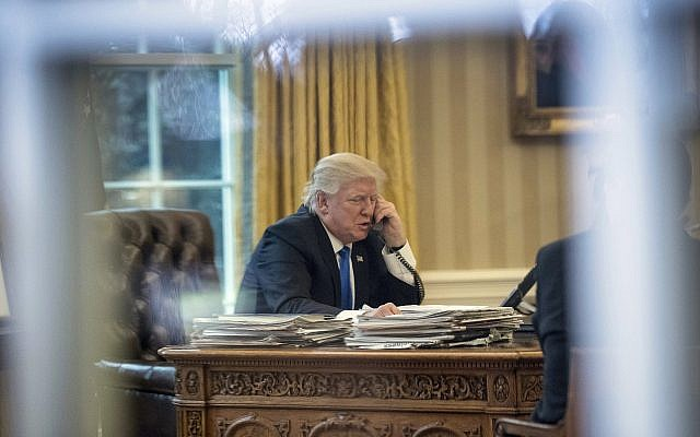 In this Jan. 28, 2017, file photo, President Donald Trump speaks on the phone with German Chancellor Angela Merkel in the Oval Office at the White House in Washington. (AP Photo/Andrew Harnik, )