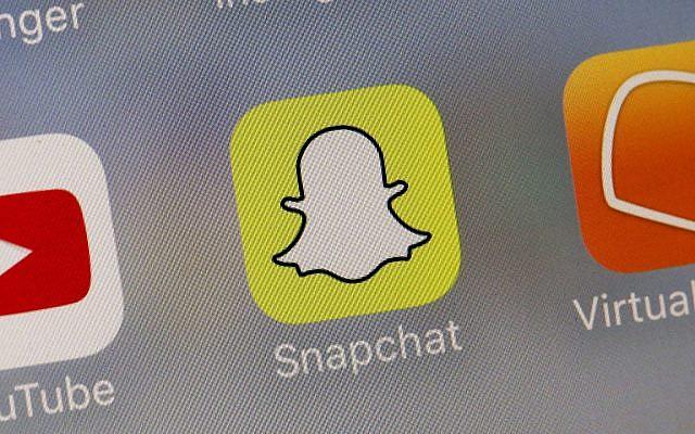This Aug. 9, 2017 photo shows the Snapchat app. (AP Photo/Richard Drew)