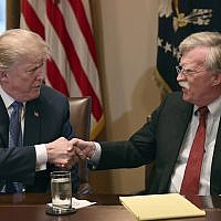 US President Donald Trump, left, shakes hands with national security adviser John Bolton in the Cabinet Room of the White House in Washington, April 9, 2018. (AP Photo/Susan Walsh)