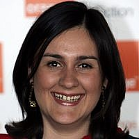 Kamila Shamsie poses for the photographers ahead of the announcement of the 2009 Orange Book prize for fiction, in London's Royal Festival Hall, June 3, 2009. (Lefteris Pitarakis/AP)