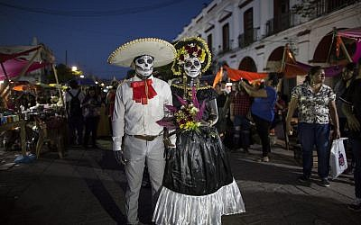 Performers in costume attend a Day of the Dead parade in Juchitan, Mexico, October 31, 2018 (AP Photo/Rodrigo Abd)