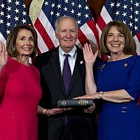 House Speaker Nancy Pelosi of Calif., administers the House oath of office to Rep. Susan Davis, D-Calif., during aceremonial swearing-in on Capitol Hill in Washington, Thursday, Jan. 3, 2019, during the opening session of the 116th Congress. (AP Photo/Jose Luis Magana)