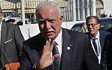 Palestinian Authority Foreign Minister Riyad al-Maliki, waves to journalists upon his arrival to attend the opening session of the Arab foreign ministers meeting ahead of the Arab Summit, in Tunis, March 29, 2019. (AP Photo/Hussein Malla)