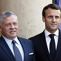 French President Emmanuel Macron, right, poses with King Abdullah II of Jordan before a meeting at the Elysee Palace in Paris, March 29, 2019. (AP Photo/Christophe Ena)