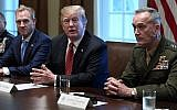 Illustrative: US President Donald Trump, center, flanked by acting Defense Secretary Patrick Shanahan, left, and Chairman of the Joint Chiefs of Staff Gen. Joseph Dunford, right, speaks during a meeting with military leaders in the Cabinet Room of the White House in Washington, Wednesday, April 3, 2019. (AP Photo/Susan Walsh)