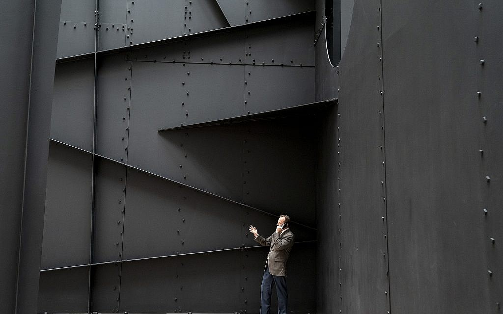 """A man finds privacy for a phone call within the walls of """"Mountains and Clouds,"""" a sculpture by Alexander Calder in the Hart Senate Office Building on Capitol Hill in Washington, Thursday, April 11, 2019. (AP/J. Scott Applewhite)"""