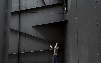 "A man finds privacy for a phone call within the walls of ""Mountains and Clouds,"" a sculpture by Alexander Calder in the Hart Senate Office Building on Capitol Hill in Washington, Thursday, April 11, 2019. (AP/J. Scott Applewhite)"