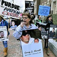 Cheryl Juaire, center, of Marlborough, Mass, leads protesters near the Arthur M. Sackler Museum at Harvard University, Friday, April 12, 2019, in Cambridge, Massachusetts.(AP Photo/Josh Reynolds)