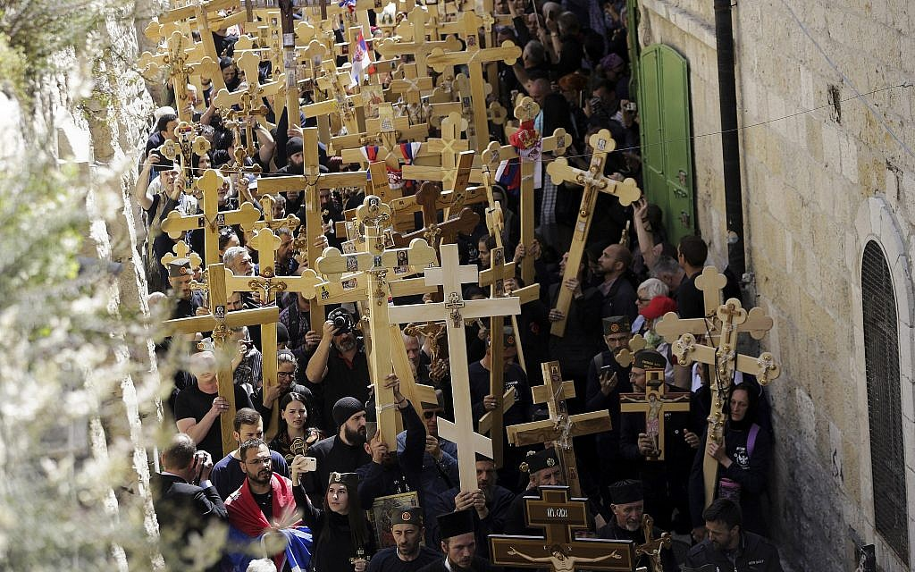 Orthodox pilgrims hold crosses during a Good Friday procession in Jerusalem, April 26, 2019. (Mahmoud Illean/AP)