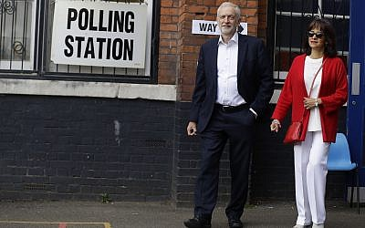 Illustrative: MP Jeremy Corbyn leader of Britain's opposition Labour Party and his wife Laura Alvarez leaves a polling station after voting in the European Elections in London, May 23, 2019. (Kirsty Wigglesworth/AP)