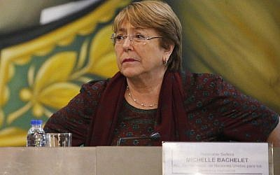 UN High Commissioner for Human Rights Michelle Bachelet listens during a meeting with Venezuela's Education Minister Aristóbulo Istúriz, at the Foreign Ministry, in Caracas, Venezuela, Thursday, June 20, 2019. (AP Photo/Ariana Cubillos)