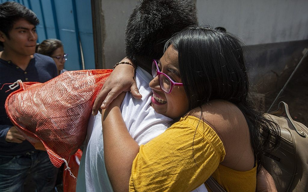 Illustrative: A woman embraces a Guatemalan migrant who was deported from the United States, after arriving at the Air Force Base in Guatemala City, Tuesday, July 16, 2019. (AP Photo/Moises Castillo)