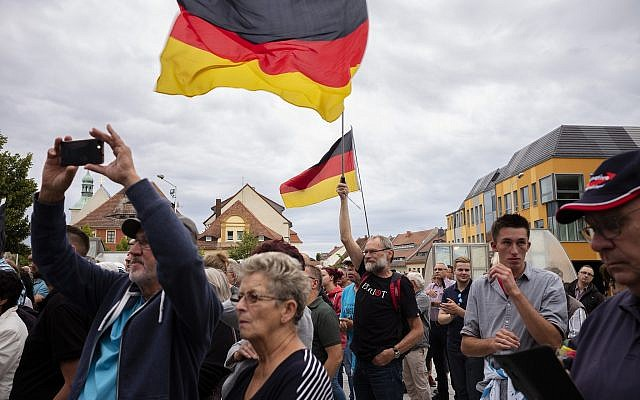 In this Aug. 15, 2019 photo, a crowd of people attend an election campaign rally of German Alternative for Germany, AfD, party for the Saxony state elections in Bautzen, Germany (AP Photo/Markus Schreiber)