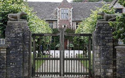A gate protects the entrance of the Rooksnest estate near Lambourn, England, Tuesday, Aug. 6, 2019. The manor is the domain of Theresa Sackler, widow of one of Purdue Pharma's founders and, until 2018, a member of the company's board of directors. A complex web of companies and trusts are controlled by the family, and an examination reveals links between far-flung holdings, far removed from the opioid manufacturer's headquarters in Stamford, Conn. (AP Photo/Frank Augstein)