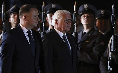 German President Frank-Walter Steinmeier, right, and Polish President Andrzej Duda, left, attend ceremony marking the 80th anniversary of World War II, in Wielun, Poland,  Sept. 1, 2019. (AP Photo/Czarek Sokolowski)