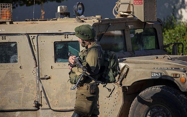 An Israeli soldier secures the village of Avivim on the Israel-Lebanon border, Monday, Sept. 2, 2019 (AP Photo/Ariel Schalit)