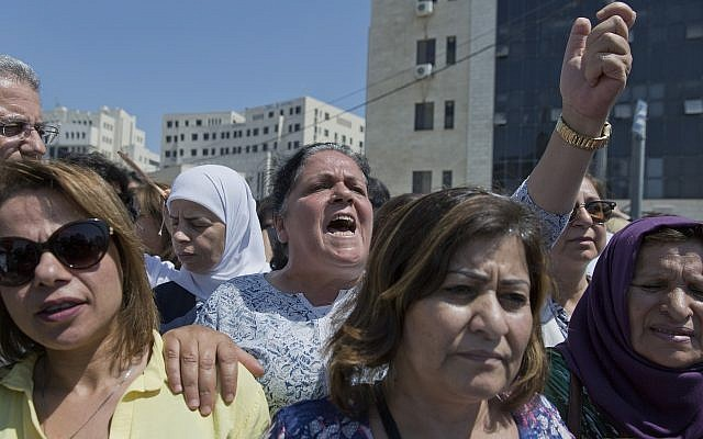 A Palestinian woman chants slogans during a rally in front of the prime minister's office, in the West Bank city of Ramallah,September 2. 2019. (AP Photo/Nasser Nasser)