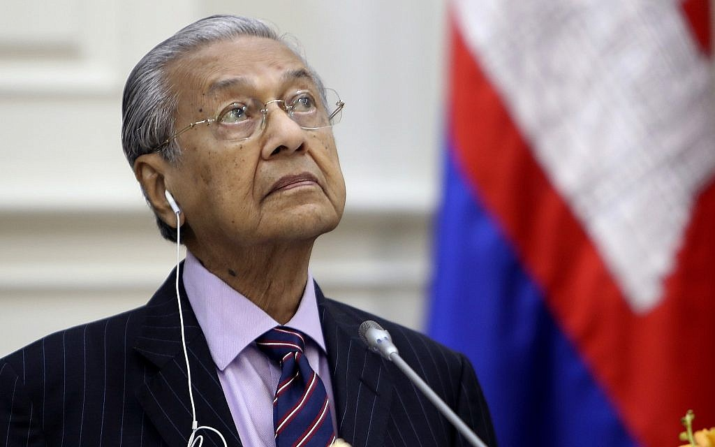 Malaysian Prime Minister Mahathir Mohamad pauses during a press conference at Peace Palace in Phnom Penh, Cambodia, Tuesday, Sept. 3, 2019. (AP Photo/Heng Sinith)