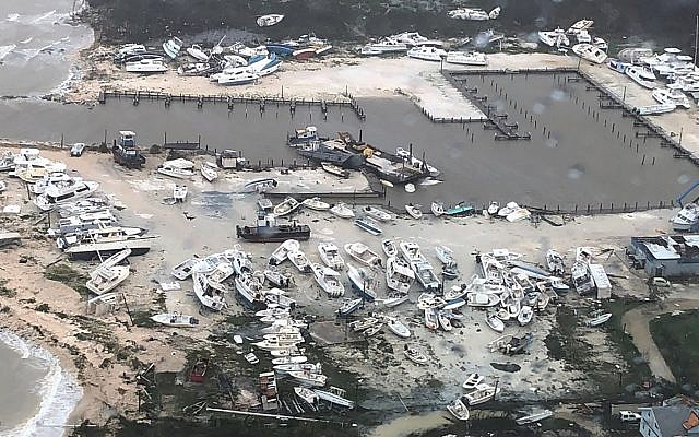 In this September 2, 2019 photo released by the US Coast Guard Station Clearwater, boats litter the area around marina in the Bahamas after they were tossed around by Hurricane Dorian. (US Coast Guard Station Clearwater via AP)