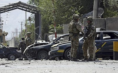 Resolute Support (RS) forces inspect the site of a car bomb explosion in Kabul, Afghanistan, Sept. 5, 2019 (AP Photo/Rahmat Gul)