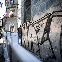 'Nazi-Kiez' sprayed on a wall, opposite a house on which imperial flags hang out of the windows in Dortmund' Germany, Sept.6, 2019 (Fabian Strauch/dpa via AP)