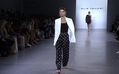 This Sept. 5, 2019 image taken from video shows a model wearing fashion from the Elie Tahari Spring/Summer 2020 collection during Fashion Week in New York. (AP Photo/Mark Cohen)