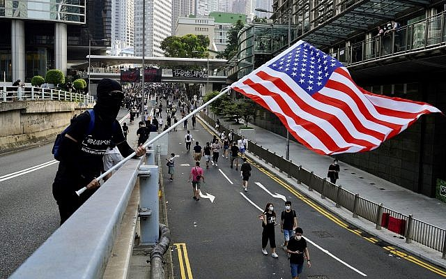 Protesters wave US flags and shout slogans as they march from Chater Garden to the US Consulate in Hong Kong Sept. 8 2019