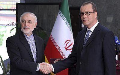 In this photo released by the Atomic Energy Organization of Iran, the head of the organization Ali Akbar Salehi, left, shakes hands with Acting Director General of the International Atomic Energy Agency, IAEA, Cornel Feruta during their meeting in Tehran, Iran, September 8, 2019. (Atomic Energy Organization of Iran via AP)