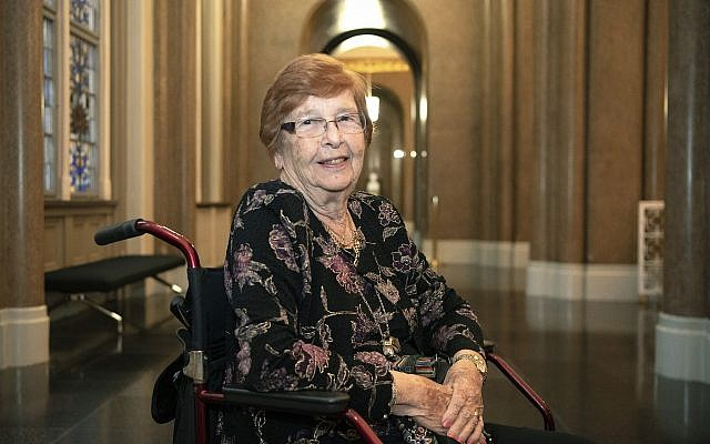 In this September 11, 2019, photo, Holocaust survivor Helga Melmed poses for a portrait during an event celebrating the 50th anniversary of a program for people expelled and persecuted by the Nazis and bringing tens of thousands of them back to their home city for one-week trips in Berlin. (Paul Zinken/dpa via AP)