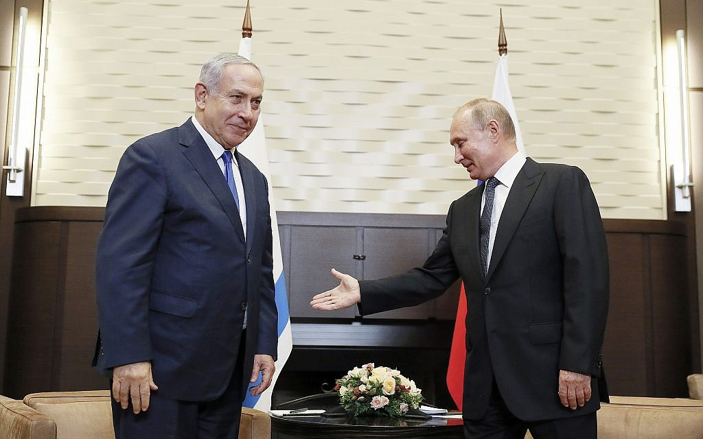 Russian President Vladimir Putin, right, welcomes Israeli Prime Minister Benjamin Netanyahu during their meeting in Sochi, Russia, September 12, 2019. (Shamil Zhumatov/Pool Photo via AP)