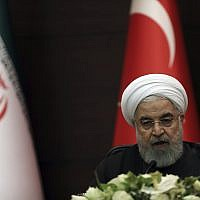 Iran's President Hassan Rouhani speaks during a joint news conference at a trilateral meeting with the leaders of Russia and Turkey in Ankara, Turkey, September 16, 2019. (Burhan Ozbilici/AP)