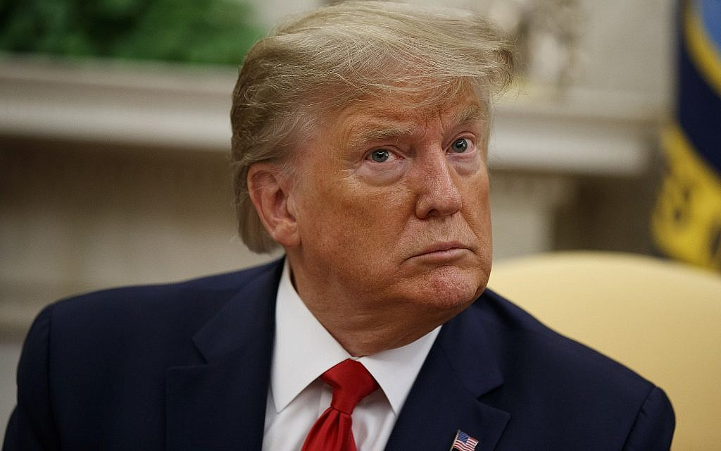 US President Donald Trump listens to a reporter's question in the Oval Office of the White House, in Washington, September 16, 2019. (Alex Brandon/AP)